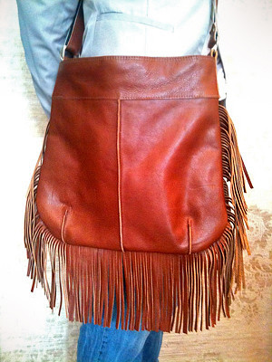 A warm brown bag with fringes