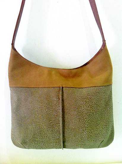 A coffe latte color leather bag combined with dark cream leather with gold leopard print.