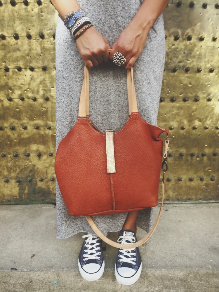 A tangerine/orange bag, that can be worn in 2 different ways.